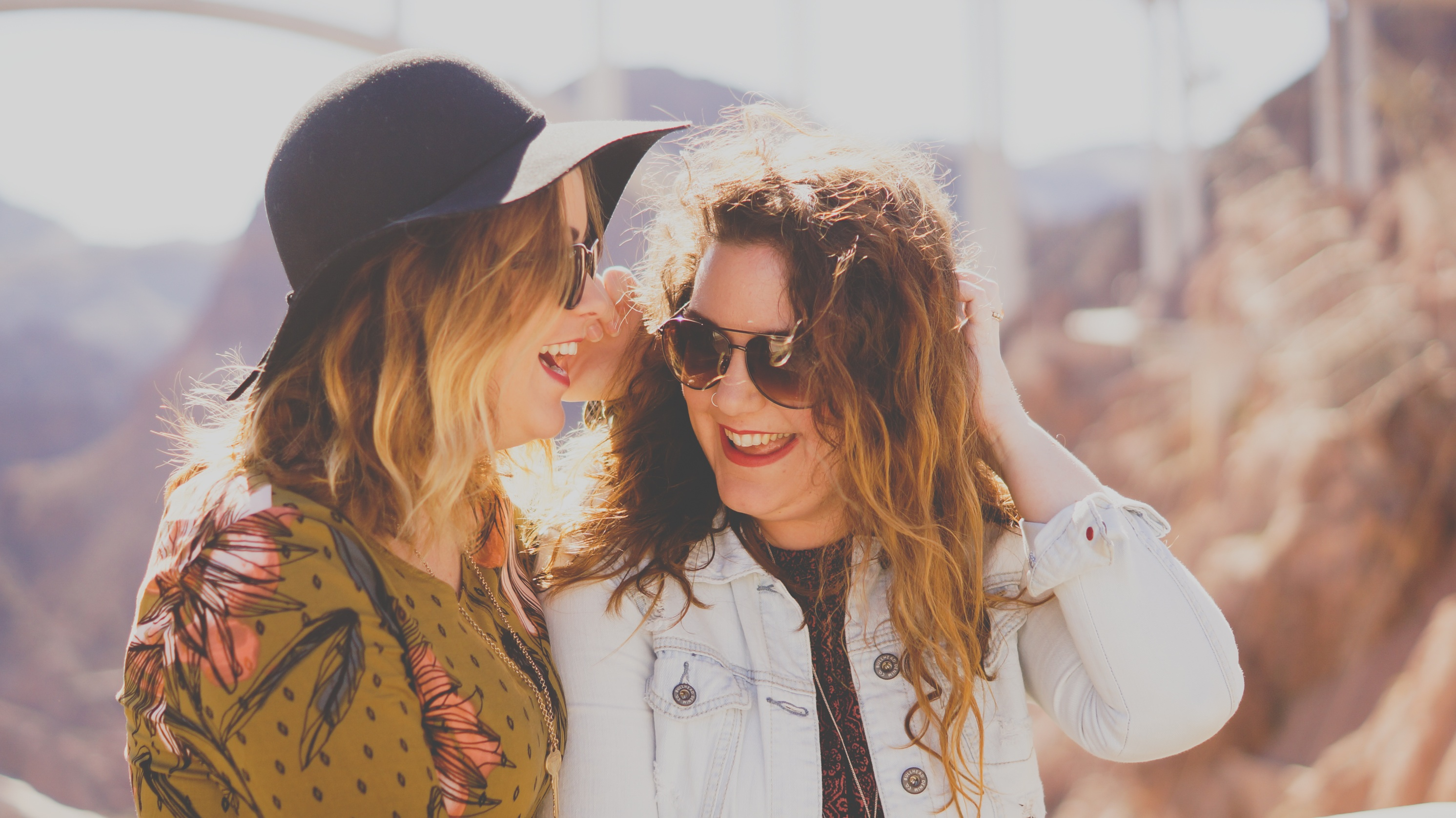 Two woman laughing blurry background